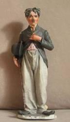 figurines en porcelaine de Chaplin et laurel et Hardy 150.00$ ch
